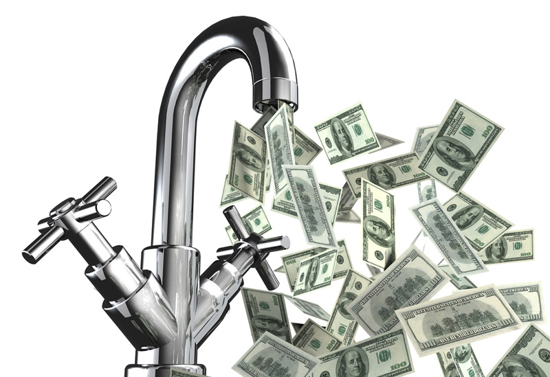This sink pouring out dollars represents doctors getting passive money flowing into their life.